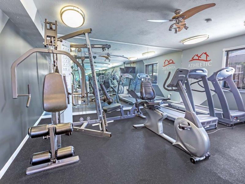 This image showcase the commercial fitness with State-of-the-art 2-level athletic club with fitness equipment that is essential for community amenities, and offering indoor cycle.