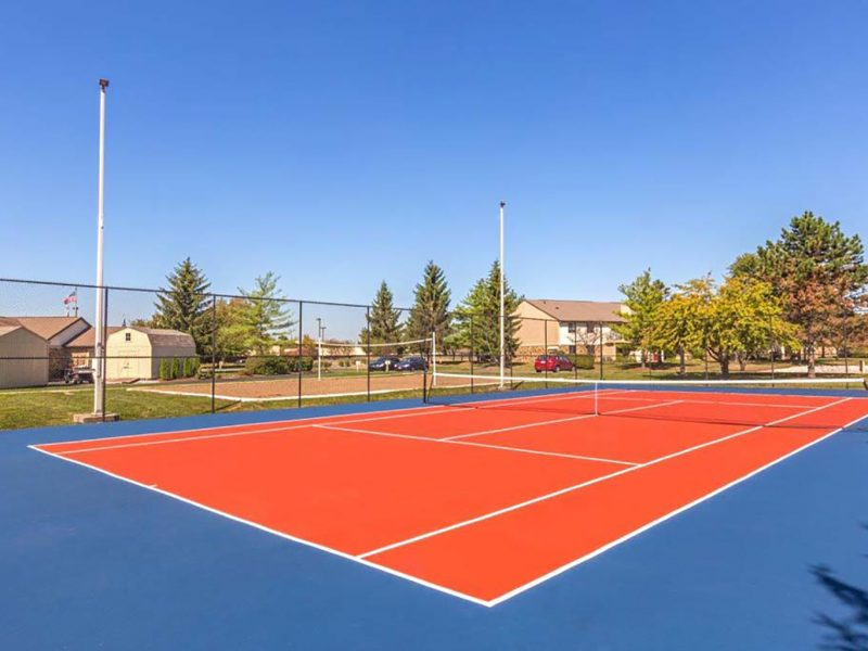 This image shows the premium community amenities, particularly the lighted tennis court with courtesy tennis balls that were ideal for a family and colleagues to enjoy.